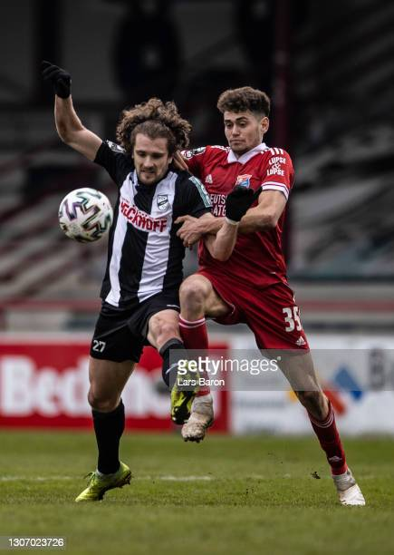 Mael Corboz of Verl is challenged by Alexander Fuchs of Unterhaching during the 3. Liga match between SC Verl and SpVgg Unterhaching at Benteler...