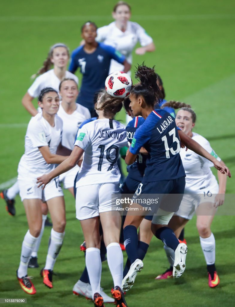 Maelle Lakrar #13 of France jumps for a header with Maggie Jenkins of New Zealand during the FIFA U-20 Women's World Cup France 2018 group A match between France and New Zealand at Stade de la Rabine on August 8, 2018 in Vannes, France.