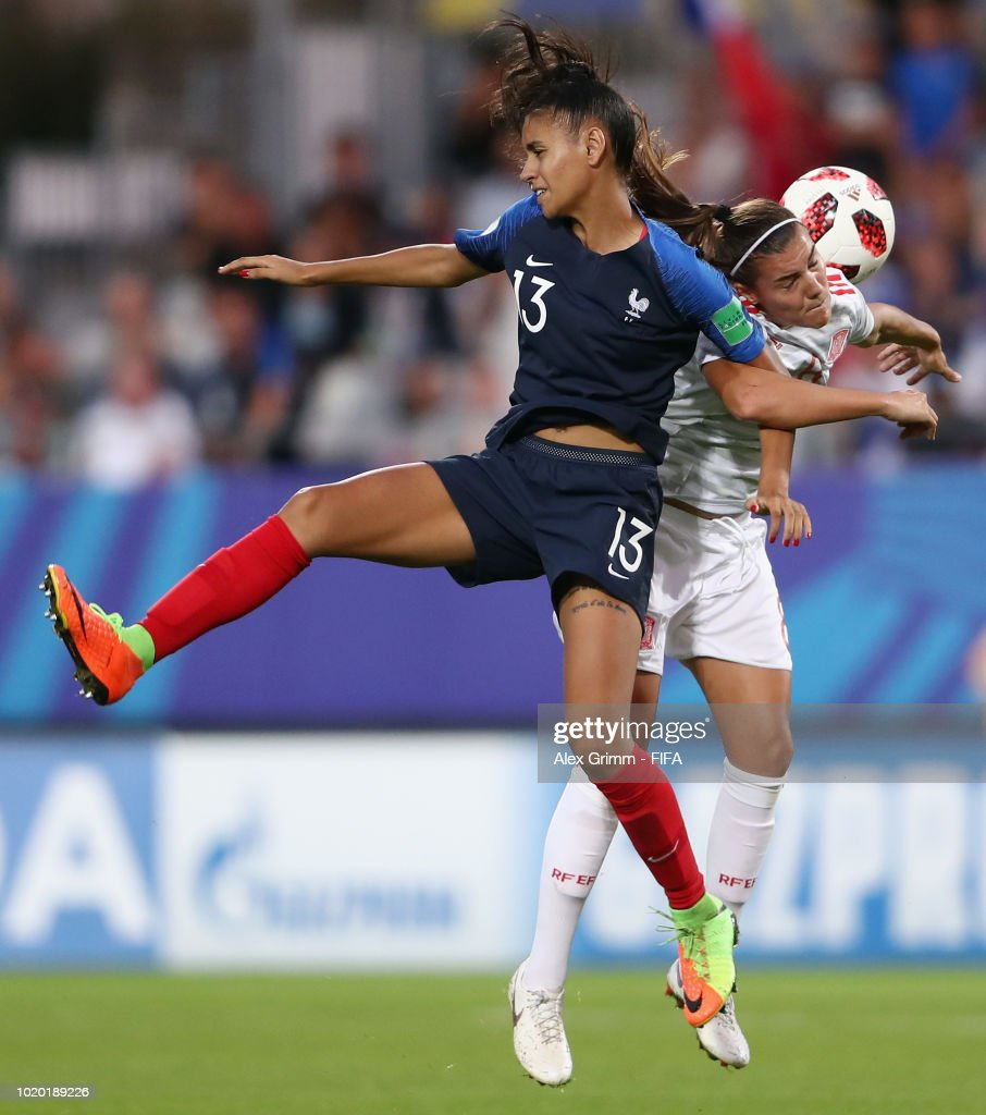 Maelle Lakrar of France jumps for a header with Patricia Guijarro of Spain during the FIFA U-20 Women's World Cup France 2018 Semi Final semi final match between France and Spain at Stade de la Rabine on August 20, 2018 in Vannes, France.