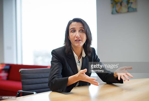 Maelys Castella chief financial officer of Akzo Nobel NV gestures as she speaks during an interview at the company's headquarters in Amsterdam...