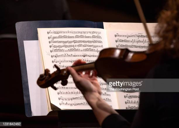 Maestro Gianandrea Noseda, who recently returned from Italy, rehearses with a small contingent of orchestra members at the Kennedy Center for a...