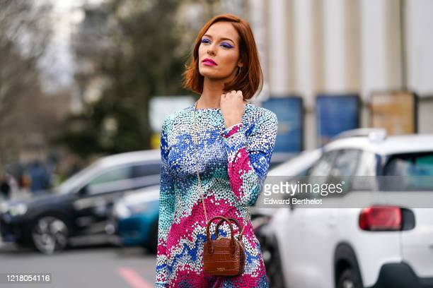 Maeva Coucke, Miss France 2018 and Miss Nord-Pas-de-Calais 2017, wears a blue and pink colorful dress, a brown Lancel leather crocodile pattern...