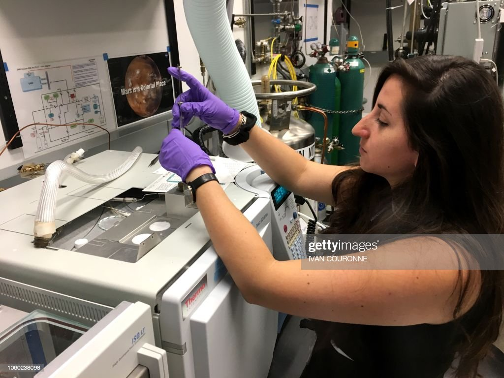 Maeva Millan, postdoctoral researcher, works in a lab at NASA's