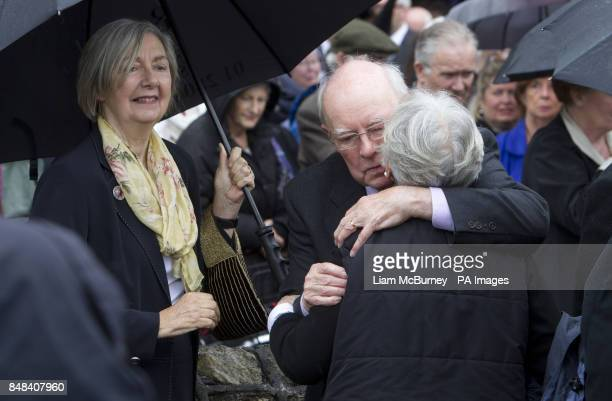 Maeve Binchy's sister Joan looks on as Maeve's husband Gordon Snell is comforted by a mourner, following her funeral at the Church of the Assumption,...
