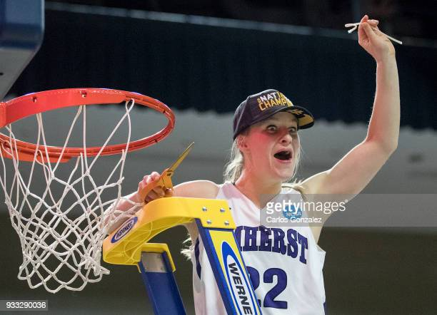 Maeve McNamara of Amherst College cut down the net after winning the Division III Women's Basketball Championship held at the Mayo Civic Center on...