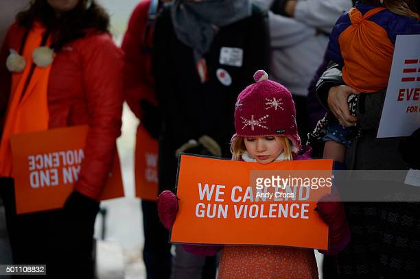 Maeve Moore attends a Moms Demand Action to end gun violence rally with her parents at the Cheeseman Park pavilion December 12 2015 The rally marked...
