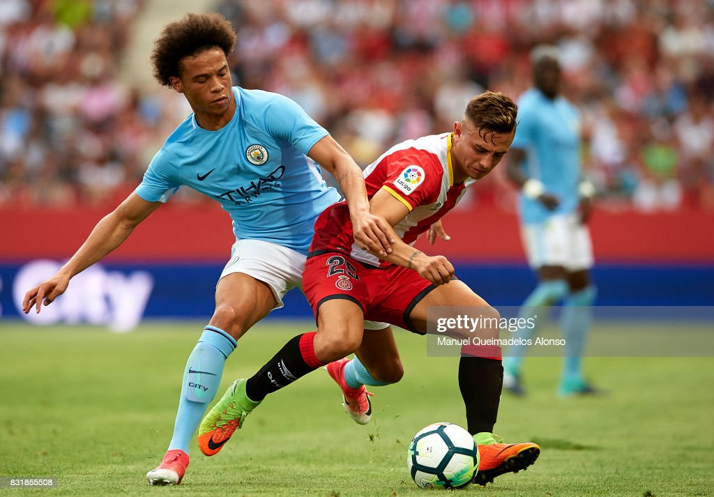 Maffeo (R) of Girona is challenged by Leroy Sane of Manchester City during the pre-season friendly match between Girona and Manchester City at Municipal de Montilivi Stadium on August 15, 2017 in Girona, Spain.