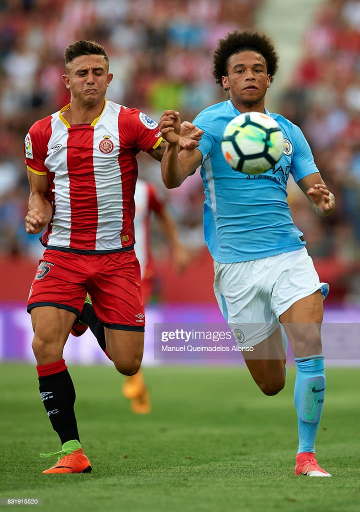 Maffeo (L) of Girona is challenged by Leroy Sane of Manchester City during the pre-season friendly match between Girona and Manchester City at Municipal de Montilivi Stadium on August 15, 2017 in Girona, Spain.