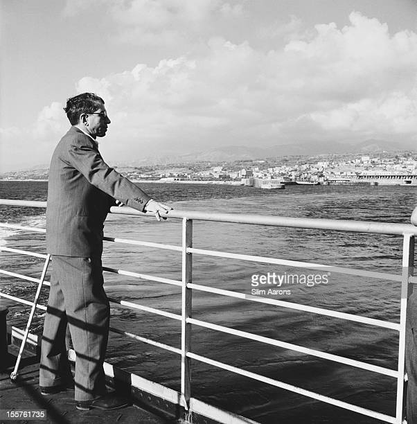Mafia boss Charles 'Lucky' Luciano looks out from the deck of a ship off the coast of Sicily Italy 31 December 1948