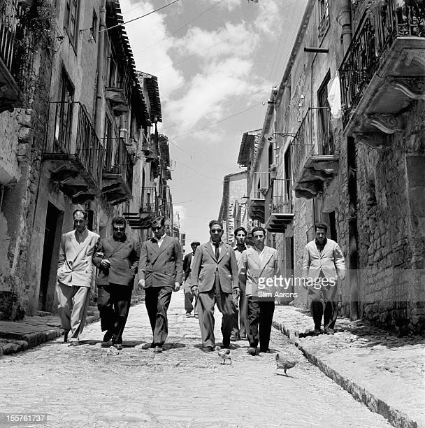 Mafia boss Charles 'Lucky' Luciano walking with his henchmen in Sicily Italy 31 December 1948