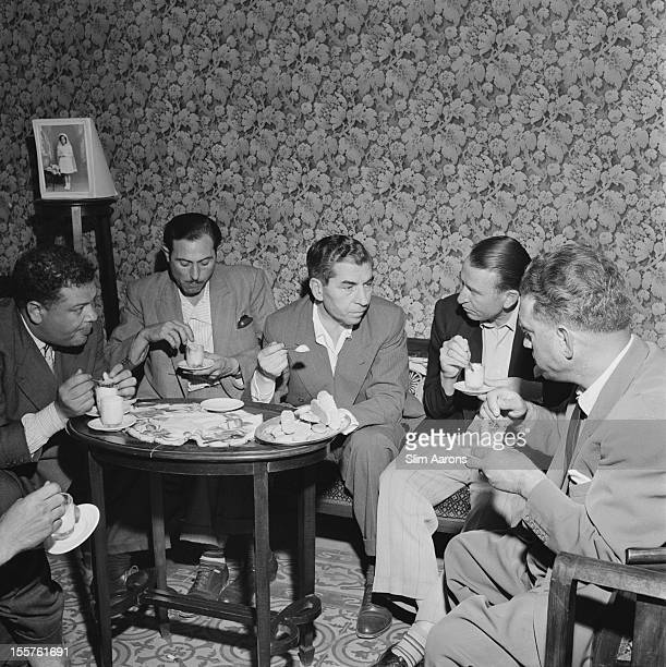 Mafia boss Charles 'Lucky' Luciano with society photographer Slim Aarons while Luciano was in exile in Sicily Italy 31 December 1948