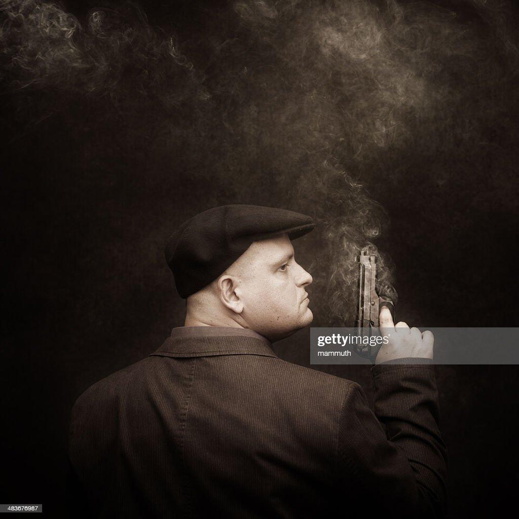 mafia guy with smoking colt : Stock Photo