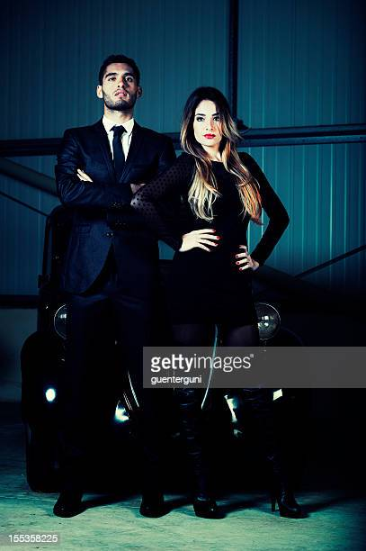 Mafia styled couple with an vintage car