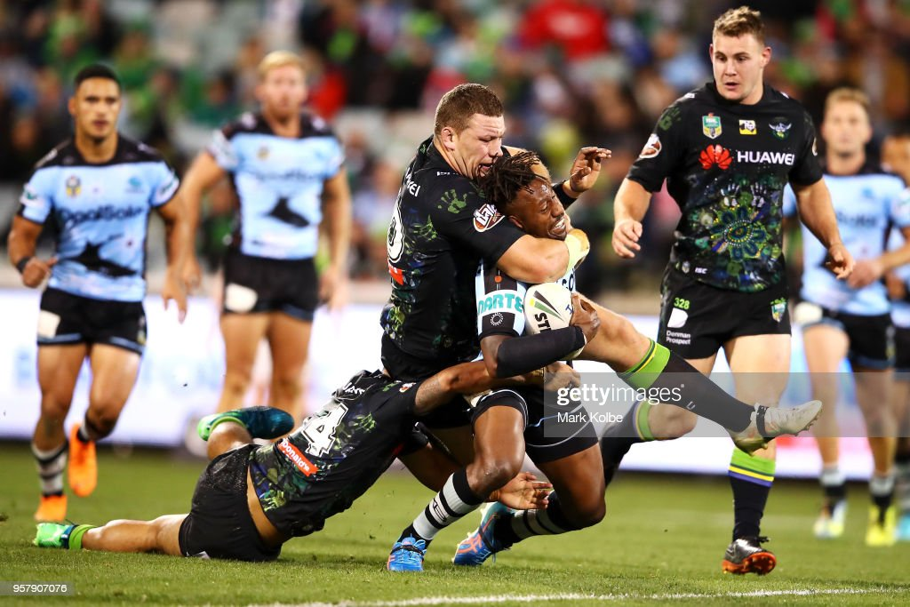 Mafoa'aeata Hingano and Shannon Boyd of the Raiders tackle James Segeyaro of the Sharks during the round 10 NRL match between the Canberra Raiders and the Cronulla Sharks at GIO Stadium on May 13, 2018 in Canberra, Australia.