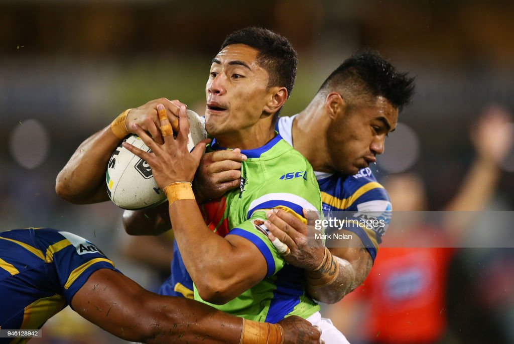 Mafoa'aeata Hingano of the Raiders is tackled during the round six NRL match between the Canberra Raiders and the Parramatta Eels at GIO Stadium on April 14, 2018 in Canberra, Australia.