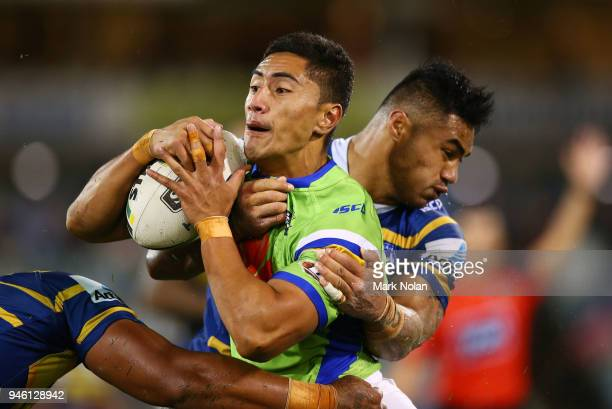 Mafoa'aeata Hingano of the Raiders is tackled during the round six NRL match between the Canberra Raiders and the Parramatta Eels at GIO Stadium on...