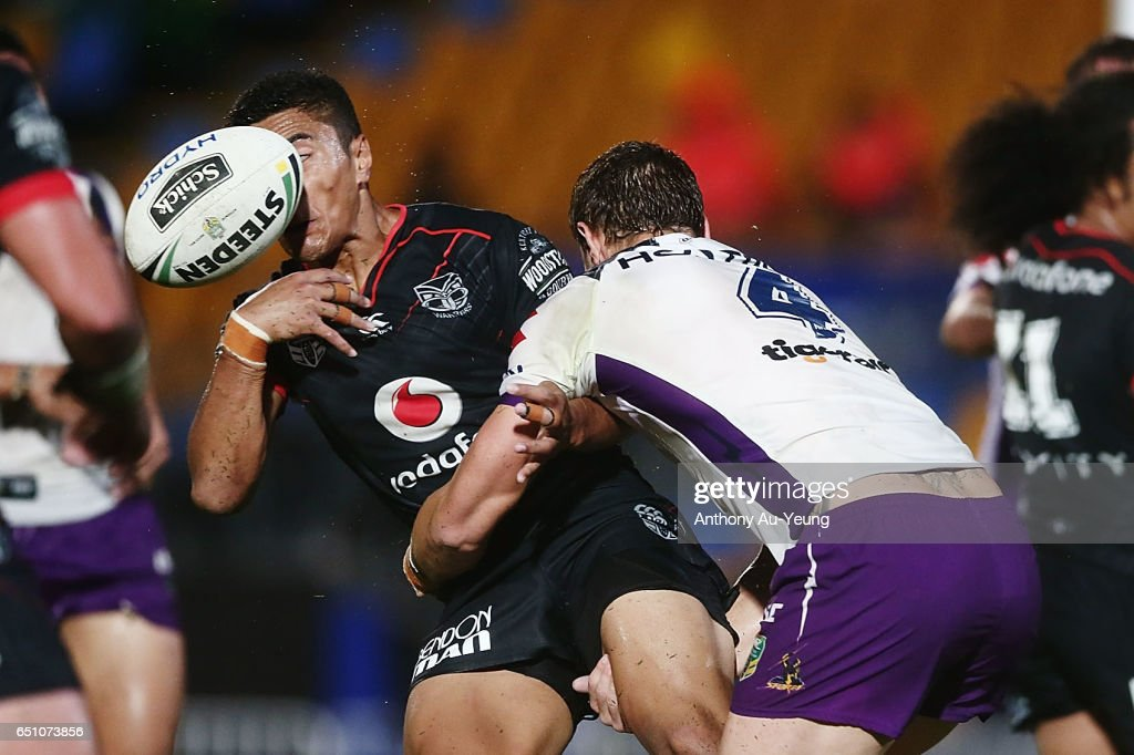 Mafoa'aeata Hingano of the Warriors loses the ball in the tackle from Cheyse Blair of the Storm during the round two NRL match between the New Zealand Warriors and the Melbourne Storm at Mt Smart Stadium on March 10, 2017 in Auckland, New Zealand.