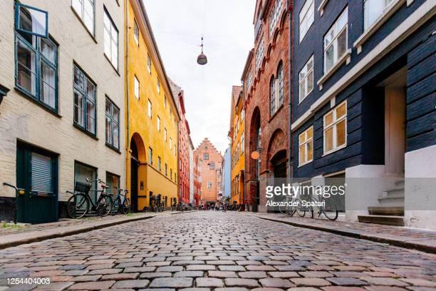 magaestrade cobbled street in copenhagen historical center, denmark - copenhagen stock pictures, royalty-free photos & images