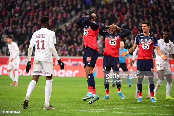 GABRIEL Magalhaes of Lille Victor OSIMHEN of Lille and Jose FONTE of Lille react after a chance is missed during the Ligue 1 match between Lille and...