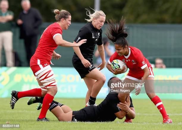 Magali Harvey of Canada is tackled during the Women's Rugby World Cup Pool A match between Canada and New Zealand Black Ferns at Billings Park UCB on...