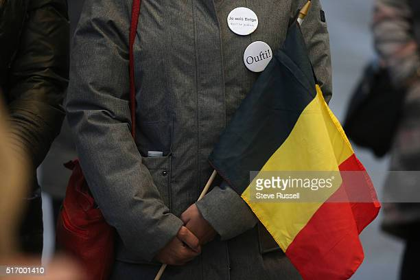 Magali Labe from Belgium holds for a moment of silence at a vigil The Toronto Sign outside City Hall sports blackyellowred of Belgium in symapathy of...