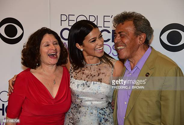 Magali Rodriguez actress Gina Rodriguez and boxing referee Genaro Rodriguez pose in the press room during The 41st Annual People's Choice Awards at...