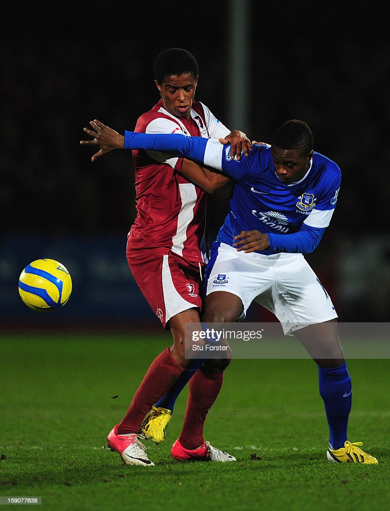 Magaye Gueye of Everton battles with Sido Jombati of Cheltenham Town during the FA Cup with Budweiser Third Round match between Cheltenham Town and Everton at Abbey Business Stadium on January 7, 2013 in Cheltenham, England.