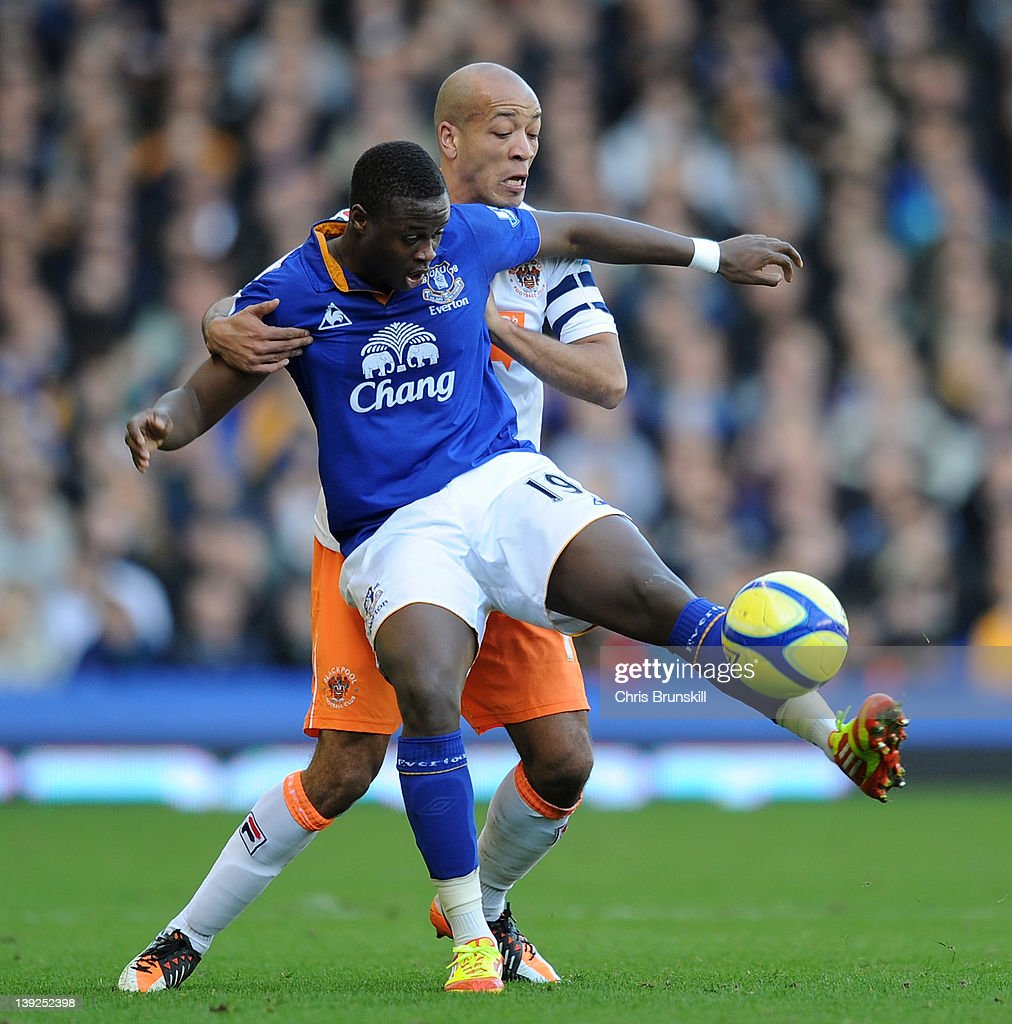 Magaye Gueye (front) of Everton in action with Alex Baptiste of Blackpool during the FA Cup Fifth Round match between Everton and Blackpool at Goodison Park on February 18, 2012 in Liverpool, England.