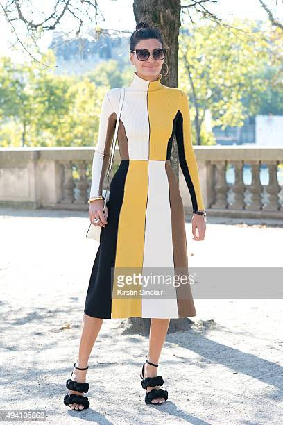 Magazine Contributor and Fashion Editor for Vogue Japan Giovanna Battaglia wears a Salvatore Ferragamo Dress Valextra bag Marco De Vincenzo shoes and...