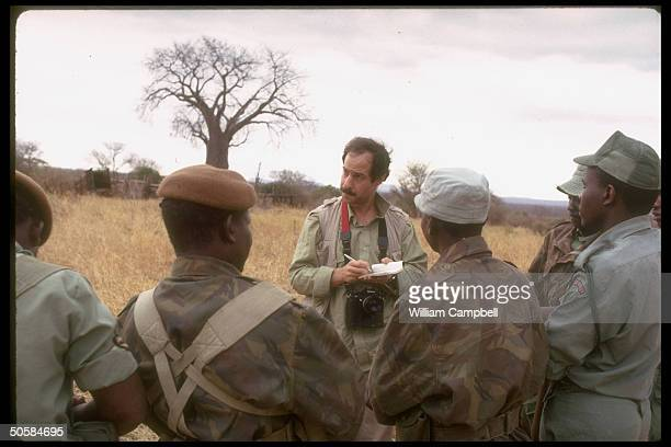 TIME magazine correspondent Ted Gup talking w members of antipoaching unit for article on ivory trade endangered elephants