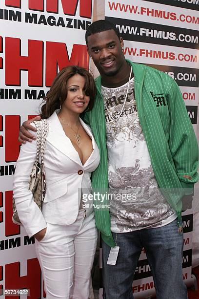 FHM magazine cover girl Vida Guerra and Cleveland Browns' cornerback Gary Baxter pose for photographers at the red carpet arrival at the FHM third...