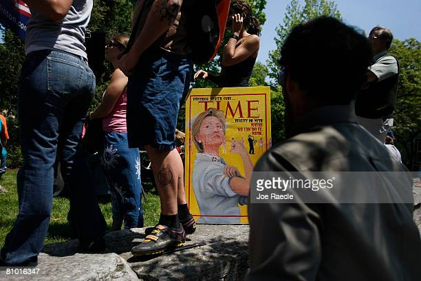 A magazine cover mock up is held by a Democratic presidential hopeful US Senator Hillary Clinton supporter during her campaign event at Shepherd...