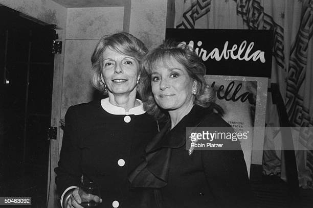 Magazine editor Grace Mirabella posing with TV interviewer Barbara Walters at a launch party for Grace's new magazine MIRABELLA at Huberts Restaurant