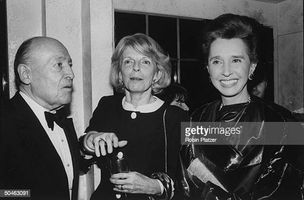 Magazine editor Grace Mirabella standing between socialite Jerry Zipkin and author spy and member of Spanish royalty Aline Countess of Romanones at a...