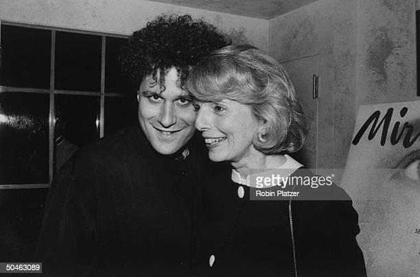 Magazine editor Grace Mirabella standing close to fashion designer Isaac Mizrahi at a launch party for her new magazine MIRABELLA at Huberts...
