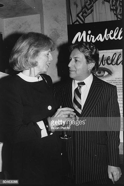 Magazine editor Grace Mirabella standing near and talking to fashion designer Arnold Scaasi at a launch party her new magazine MIRABELLA at Huberts...