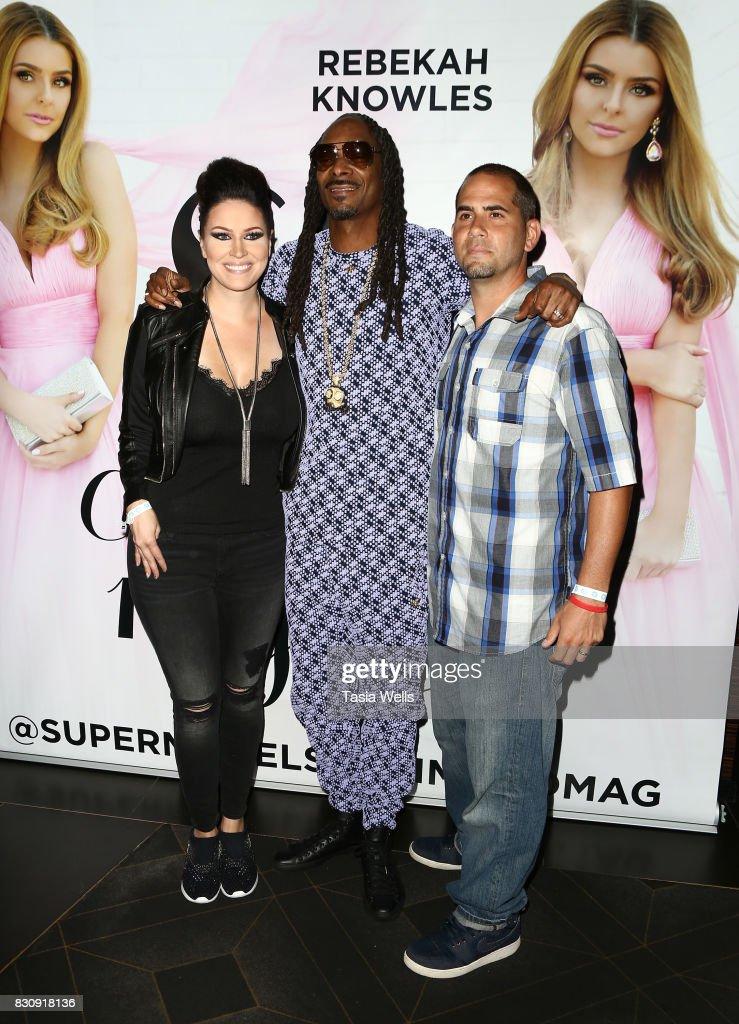 SU Magazine editor in chief Kim Clark, rapper Snoop Dogg and Jay Clark at SU Magazine's 17th Anniversary Celebration on August 12, 2017 in Hollywood, California.