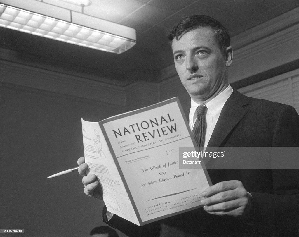 William F. Buckley Holding Book : News Photo