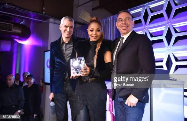 Magazine EditorinChief Aaron Hicklin Music Icon Award honoree Janet Jackson and OUT Magazine Executive VP Publishing Joe Landry pose for a photo on...