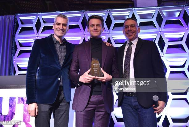 Magazine EditorinChief Aaron Hicklin OUT100 Entertainer of the Year Jonathan Groff and OUT Magazine Executive VP Publishing Joe Landry pose for a...