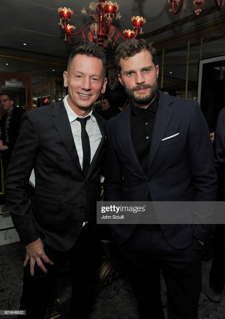 GQ Magazine Editor-In-Chief Jim Nelson (L) and Jamie Dornan attend GQ and Oliver Peoples Celebrate Timothee Chalamet March Cover Dinner at Nomad Los Angeles on February 20, 2018 in Los Angeles, California.