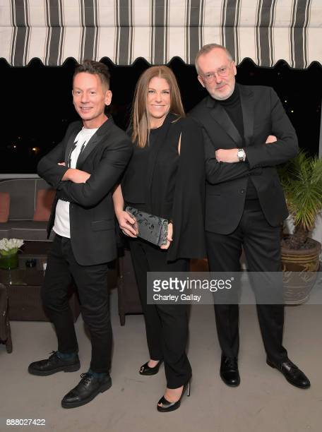GQ Magazine EditorinChief Jim Nelson CBO of GQ Kim Kelleher and GQ Creative Director Jim Moore attend GQ and Dior Homme private dinner in celebration...