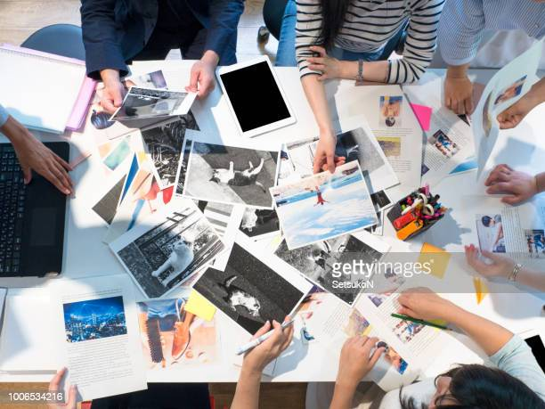 magazine editors at work. - picture magazine stock pictures, royalty-free photos & images