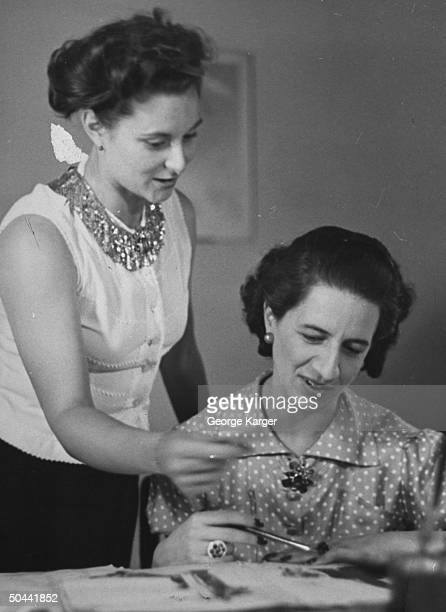 Magazine editors Peggy LeBoutillier and Diana Vreeland working on layouts about the Paris fashion shows.