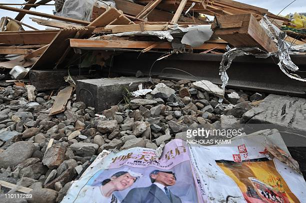A magazine featuring Jaapanese Emperor Akihito and Empress Michiko is seen in the rubble in the devastated city of Ofunato on March 15 2011 Rescue...