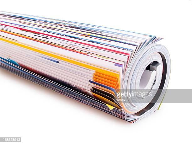 magazine roll up - rollen stockfoto's en -beelden