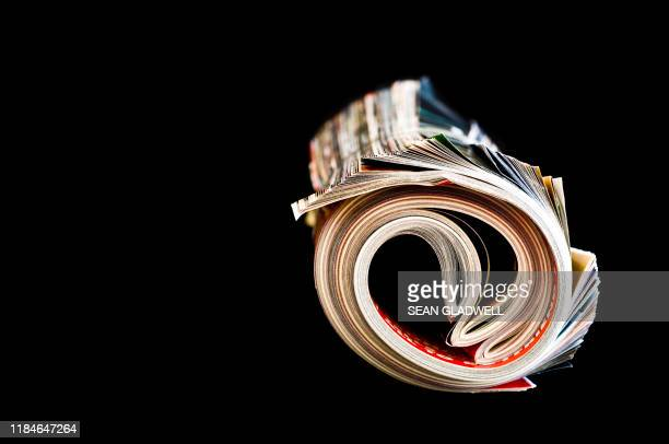magazine rolled up - magazine stock pictures, royalty-free photos & images
