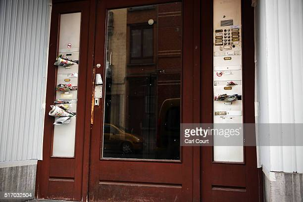 Magazines and newspapers are left in letterboxes in the doorway of the apartment block believed to be used by brothers Khalid and Brahim elBakraoui...