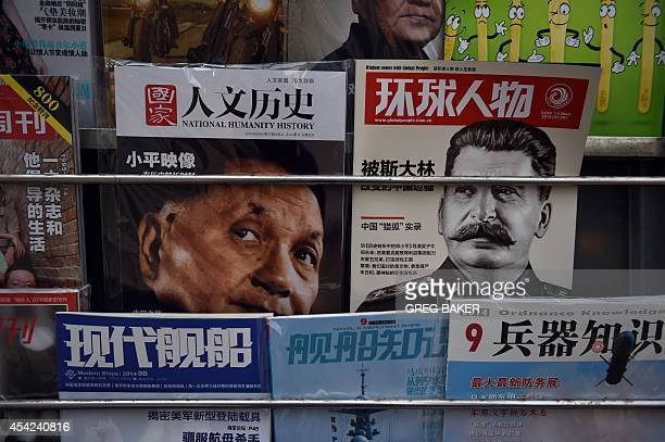 Magazines featuring articles about late Chinese paramount leader Deng Xiaoping and late Soviet leader Joseph Stalin are seen at a newsstand in...