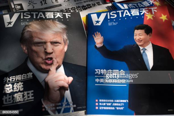 Magazines featuring front pages of US President Donald Trump and China's President Xi Jinping are displayed at a news stand in Beijing on April 6...
